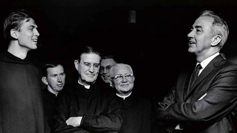 Sen. Eugene McCarthy meets with monks on a 1968 visit to St. John's, the school at which he was a standout athlete.