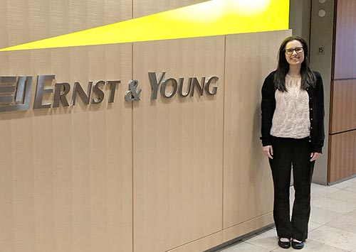 Amy in front of Ernst & Young sign