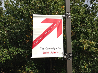 Photo of a Forward Ever Forward banner on campus