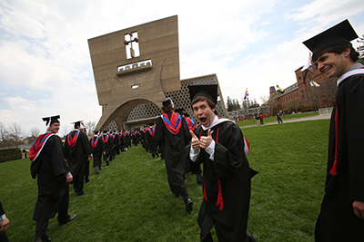 Photo of Johnnies lined up outside of the Abbey on their graduation day