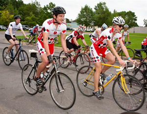 Photo of people riding bikes at the Red Ride Cycling Event
