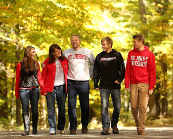 Photo of family walking through the woods at SJU