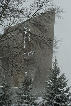 Photo of the Saint John's Abbey in the winter time speckled with snow