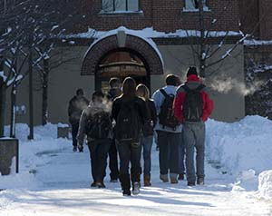 Photo of Johnnies walking in the snow to the Refectory