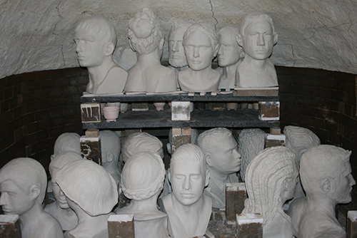 Busts loaded into wood kiln