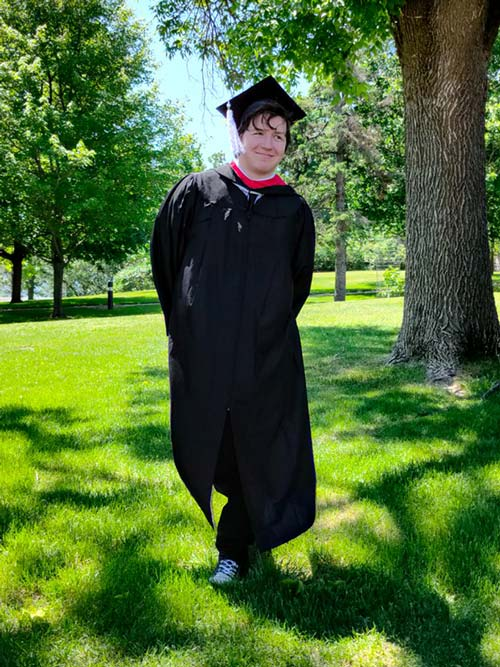 James in cap and gown